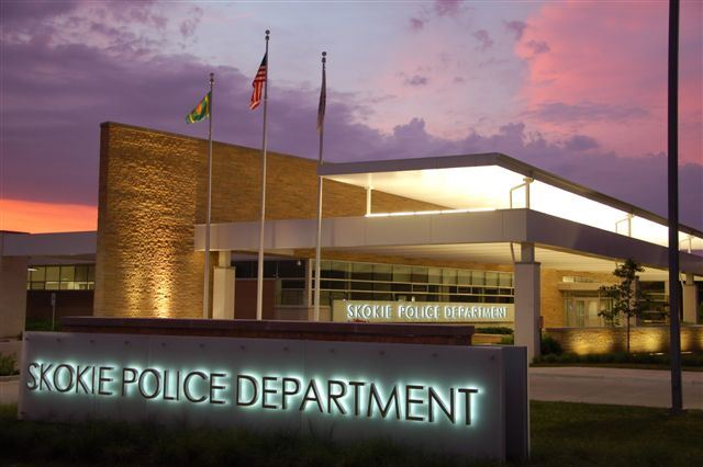 Image of Police Headquarters building facade at sunset