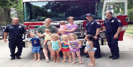 Block party photograph - children and fire fighters