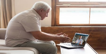 Senior Citizen Using Zoom on Computer (JPG)